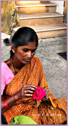 Flower Lady making gardens for the temple