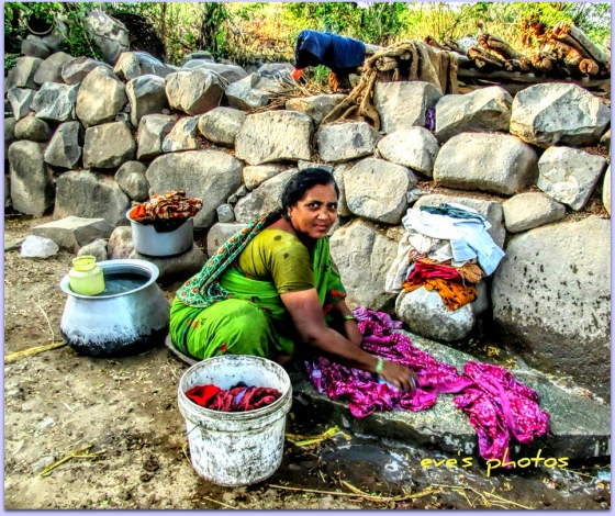Dobhi lady - washing her clothes on the rocks