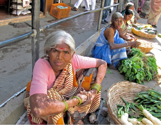 Old lady with her flowers and fruits and some vegs.. Puttaparthi, outside the temple