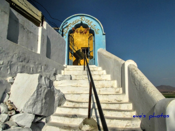 Steps to the caves, where only a few years ago, a very saintly sage, meditated for 40 years. He is buried here. Andra Pradesh, India