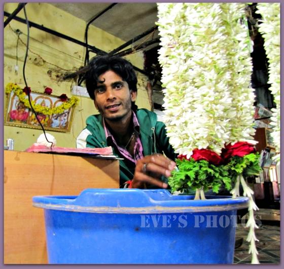 young men creating beautiful garlands