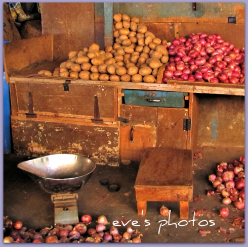 The old wooden stools still used to weigh the vegetables, the men sit on them all day long..