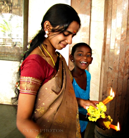 mother and daughter attending a Christmas church service, Bangalore.